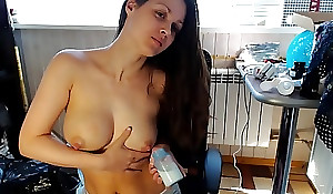 Sexy mom milking in a bottle all over an adding of compliments milk in the first place the brush face from the brush boobs!