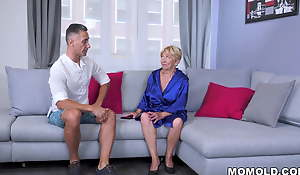 Slutty old lady Malya fucks that chum on an obstacle couch